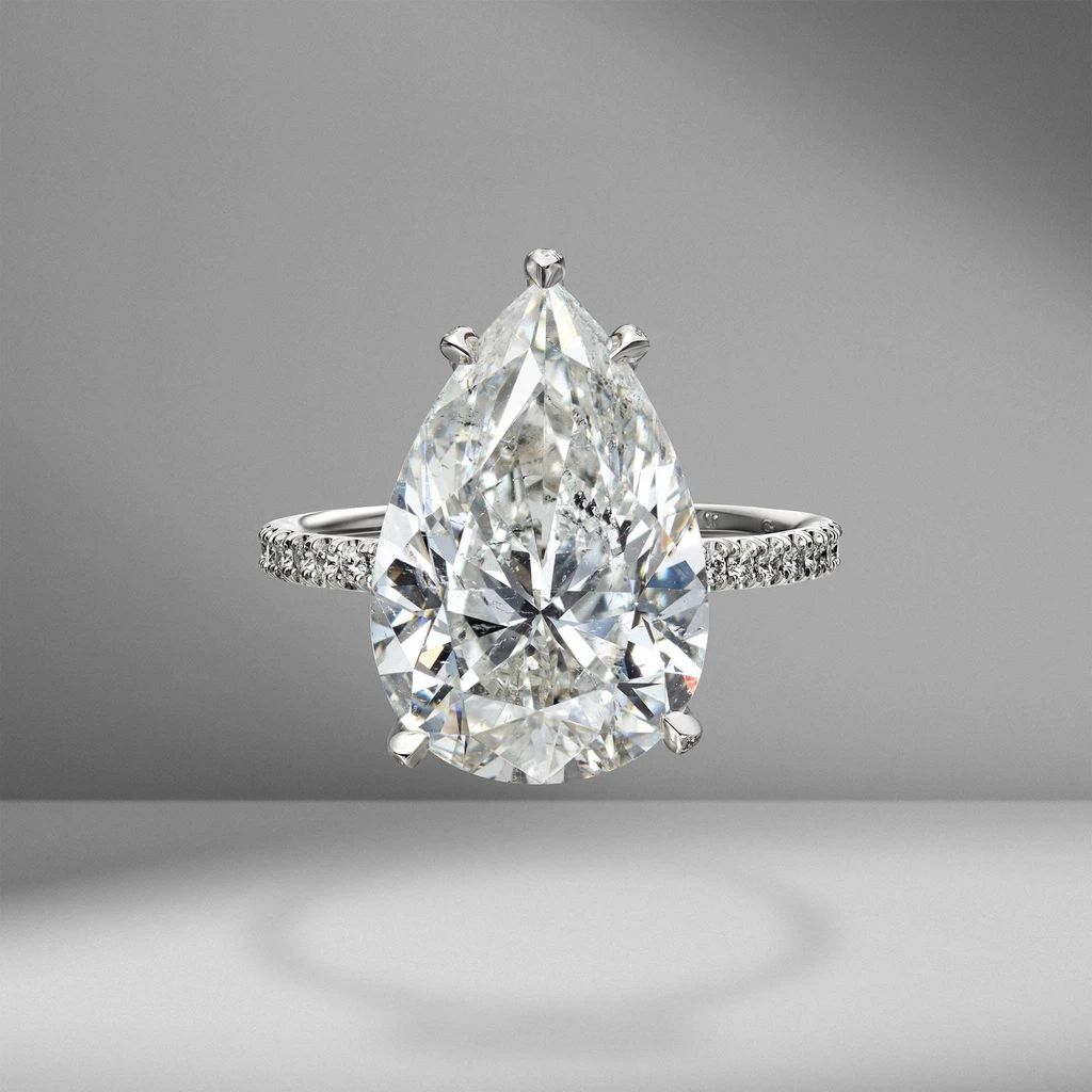 Material Good Pear Shape Engagement Ring with Diamond Pavé