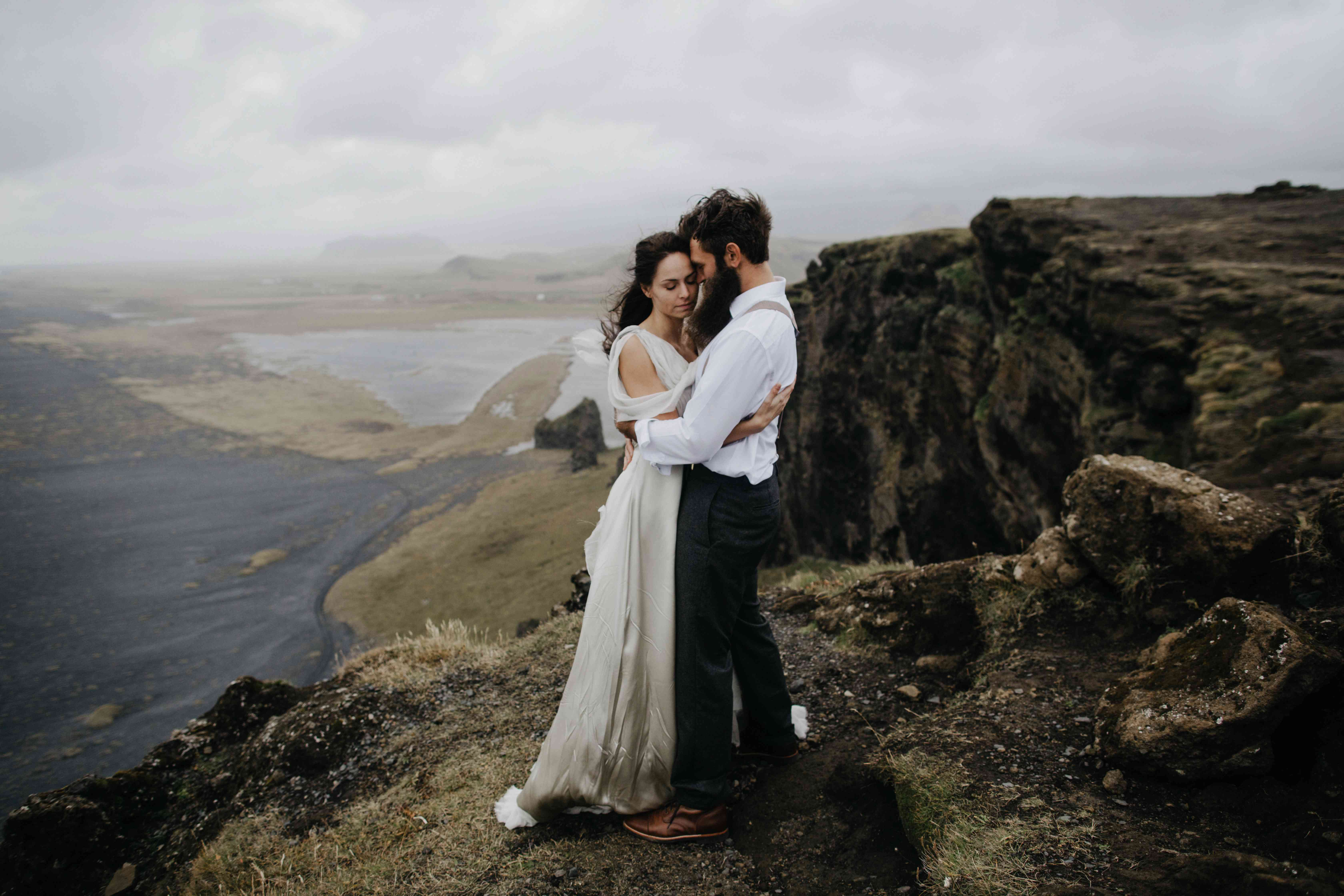 Couple hugging on a clif in Iceland