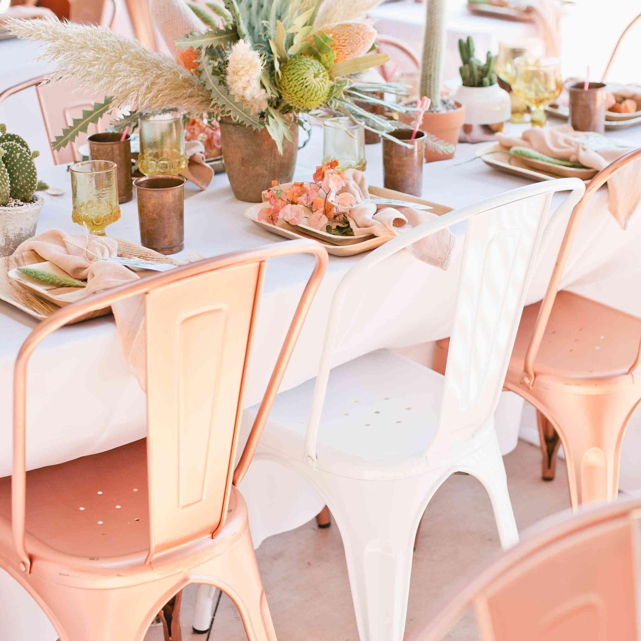 <p>Copper Wedding Reception Chairs and Cacti Centerpieces</p>