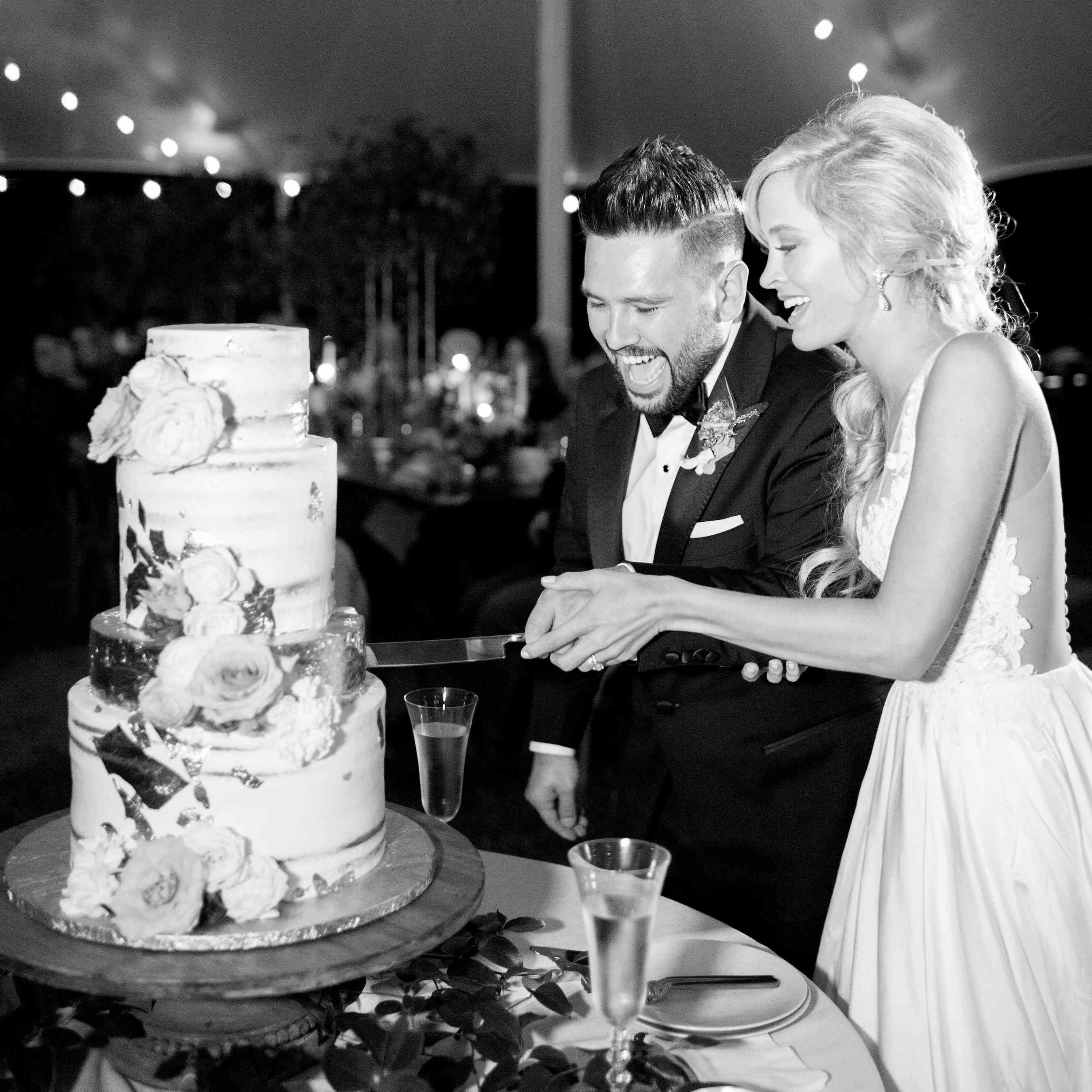 <p>Bride and groom cutting wedding cake</p><br><br>