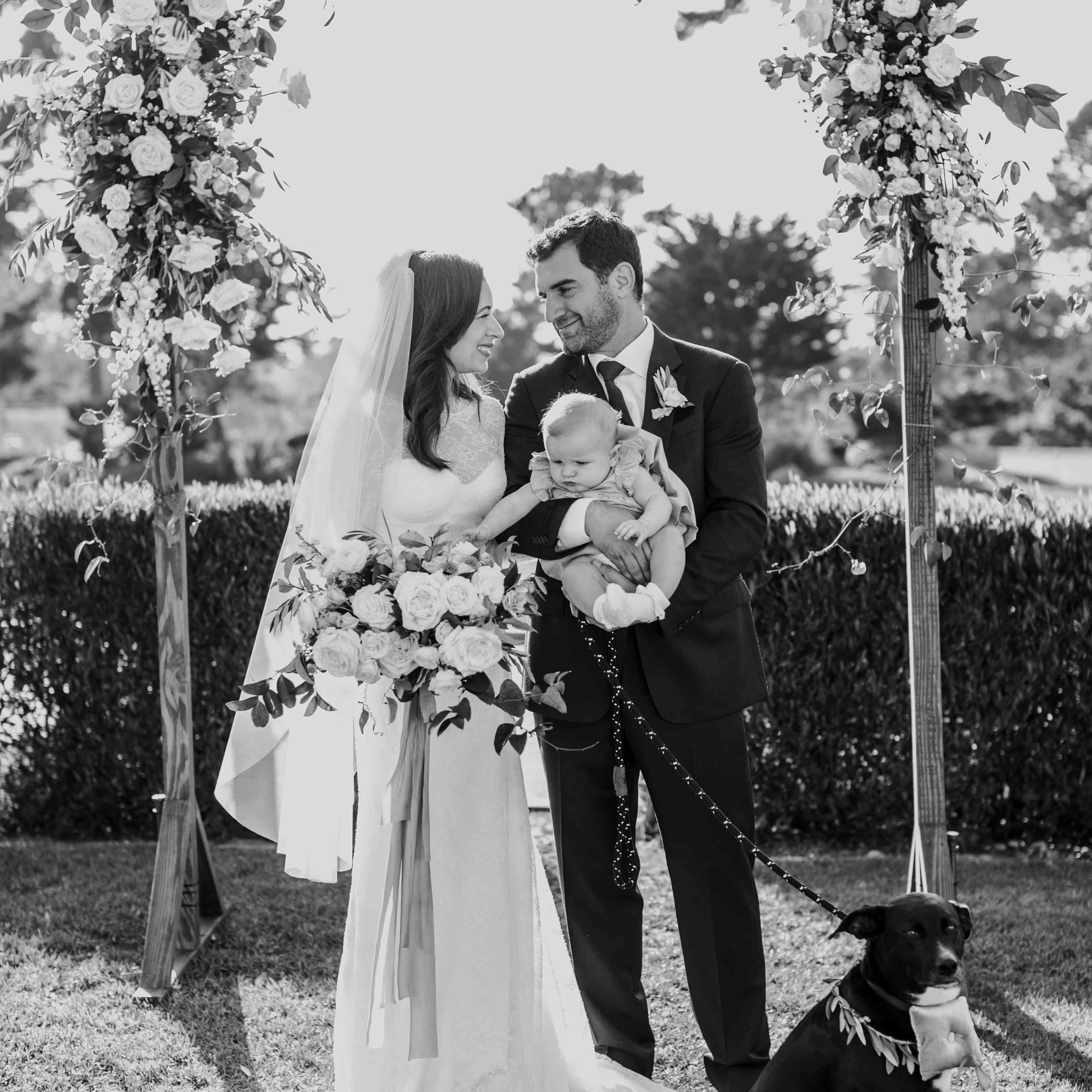 bride and groom with daughter and dog