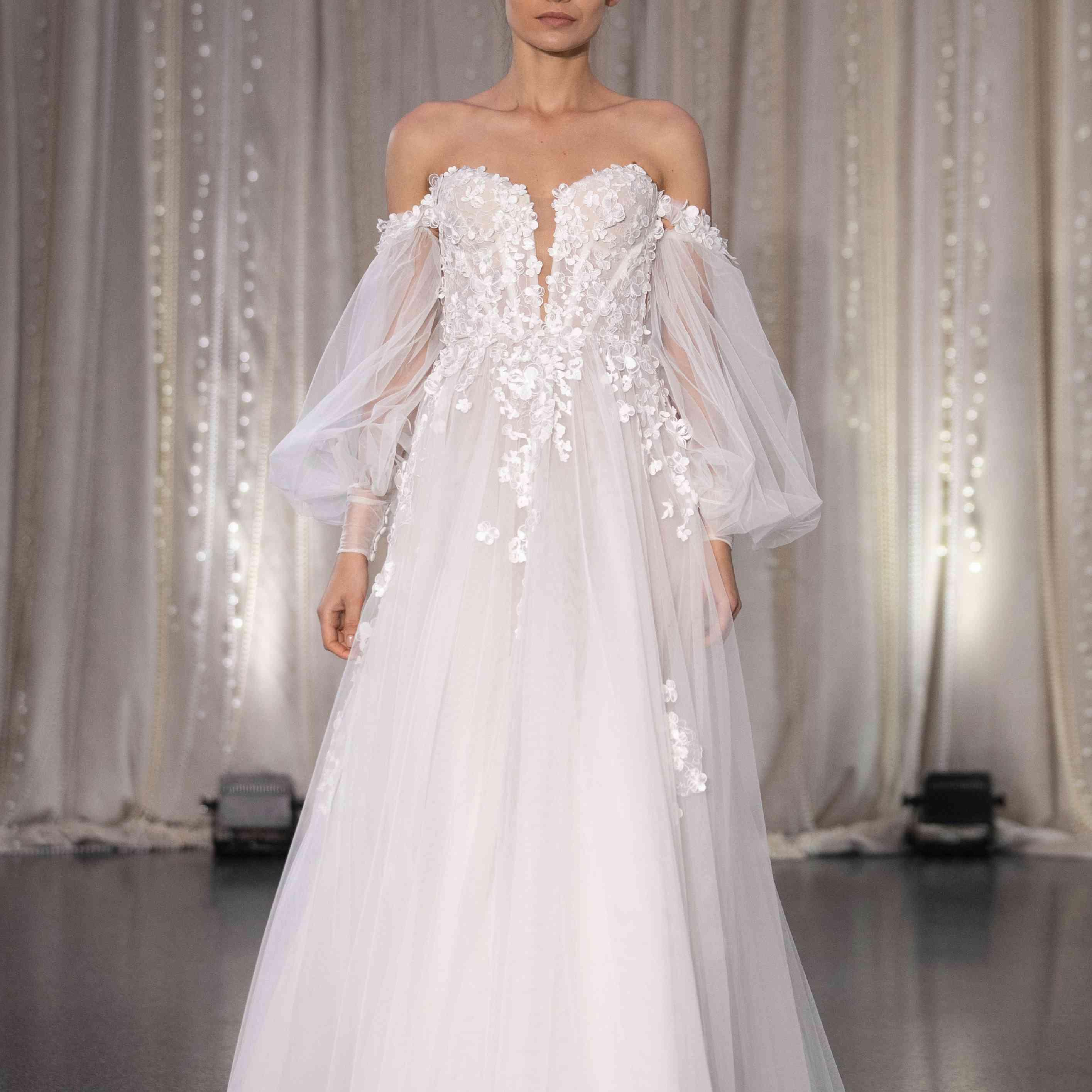 Model in off-the-shoulder tulle A-line wedding dress