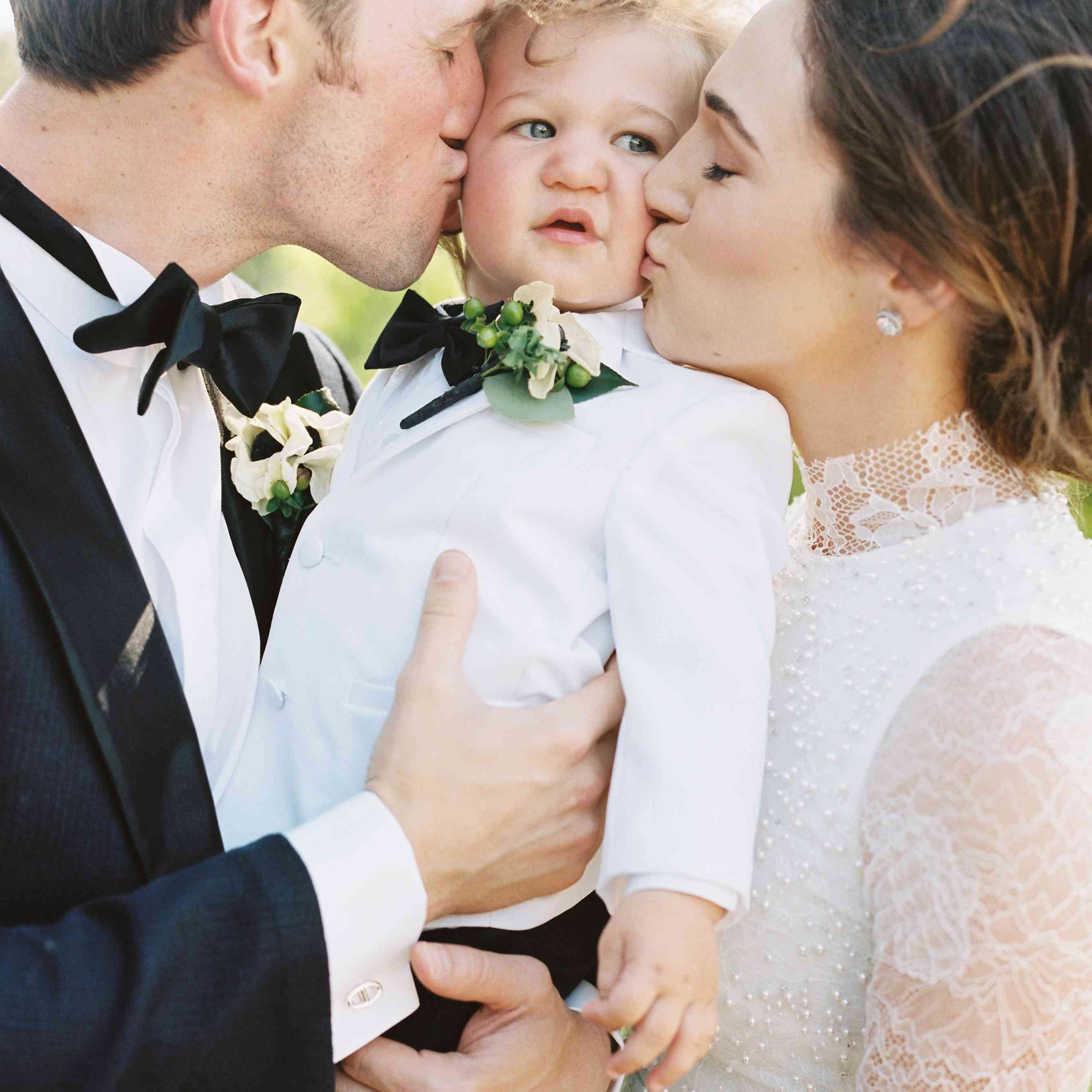 <p>Bride and groom kissing son</p><br><br>