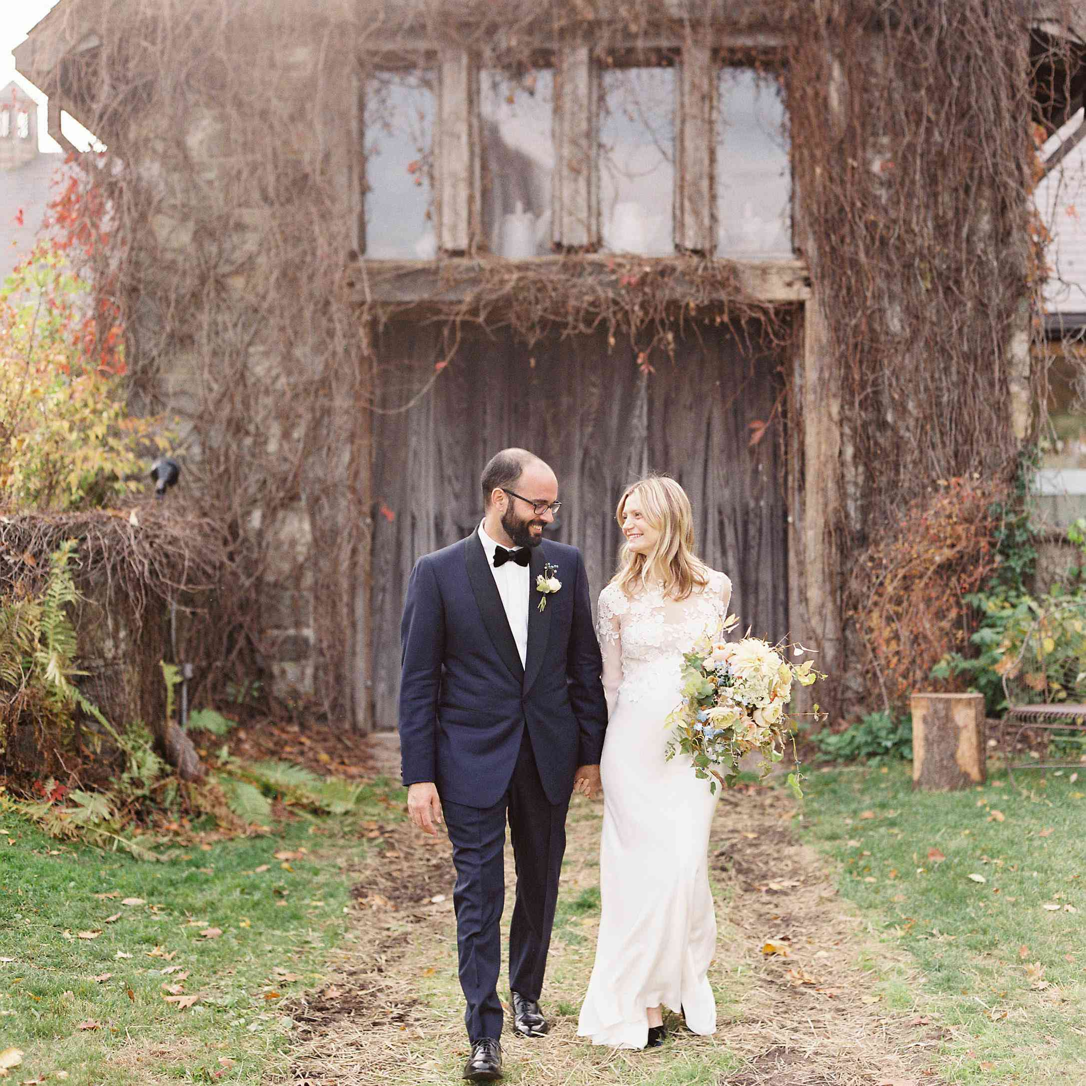 <p>Bride and groom outside barn</p><br><br>