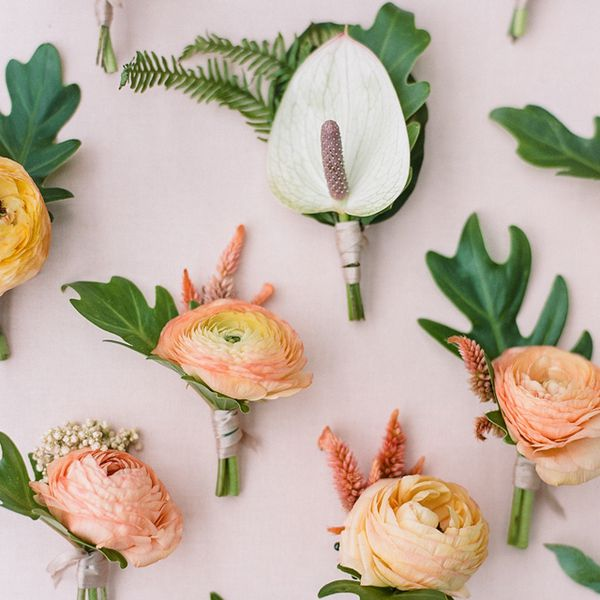 Array of tropical-inspired wedding party boutonnieres