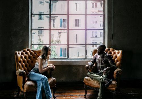 A man and woman talking.