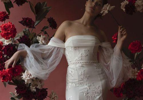 Model in off-the-shoulder wedding dress