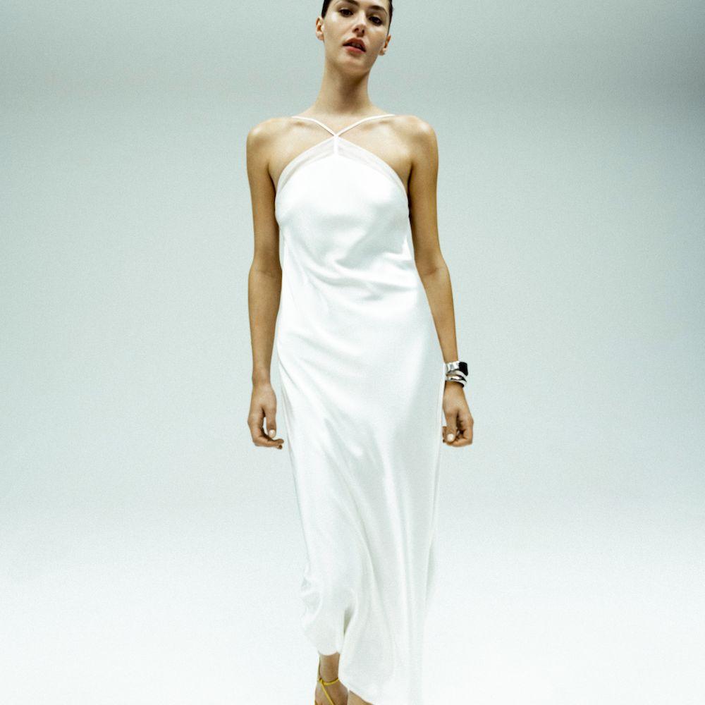 Model wearing cropped white silk slip wedding dress