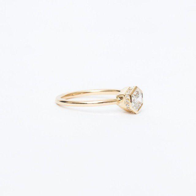 gold hidden halo engagement ring