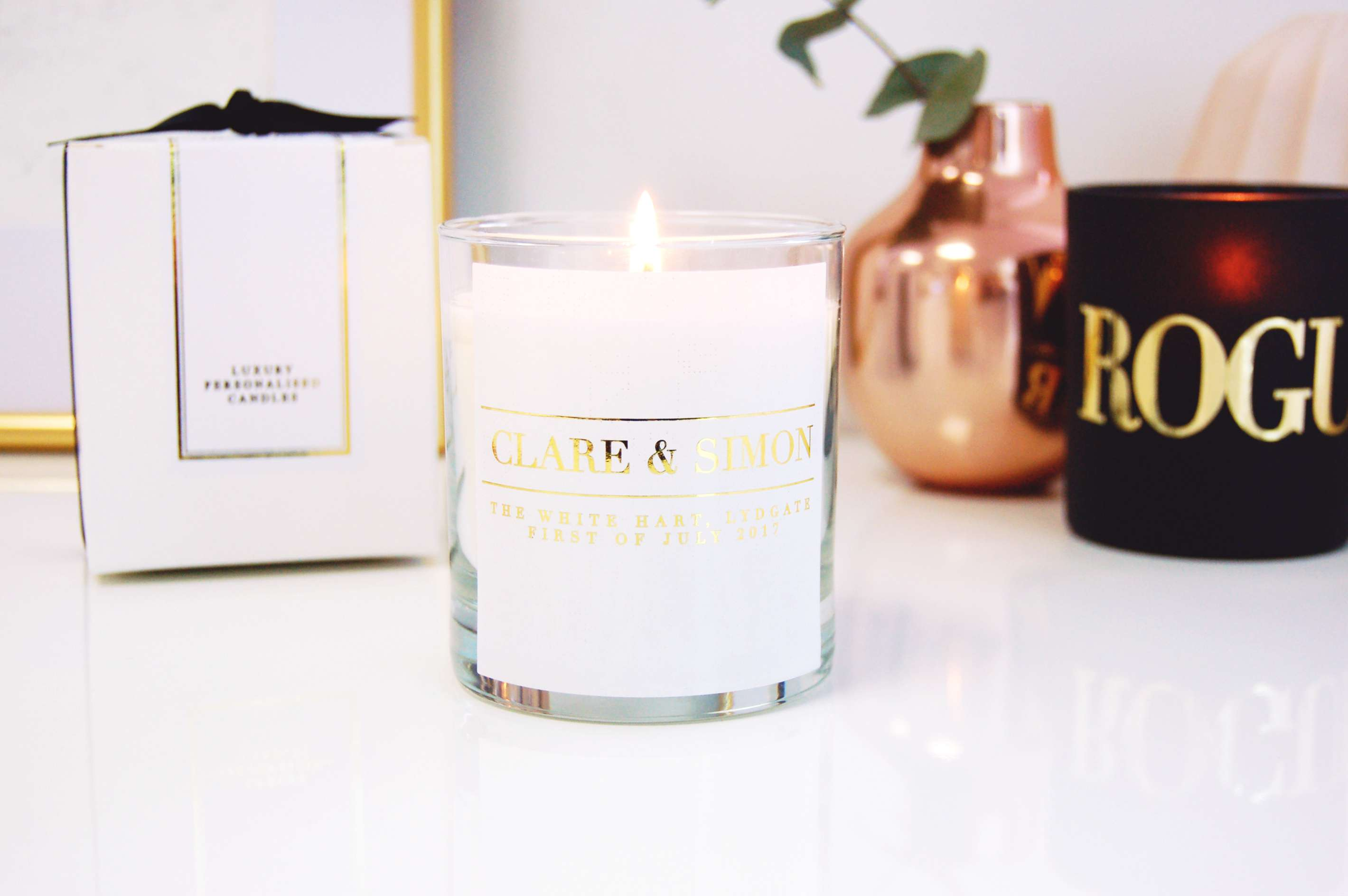 Custom candle with gold foil lettering