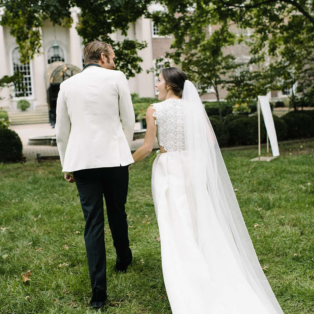 The newlyweds walk to the reception
