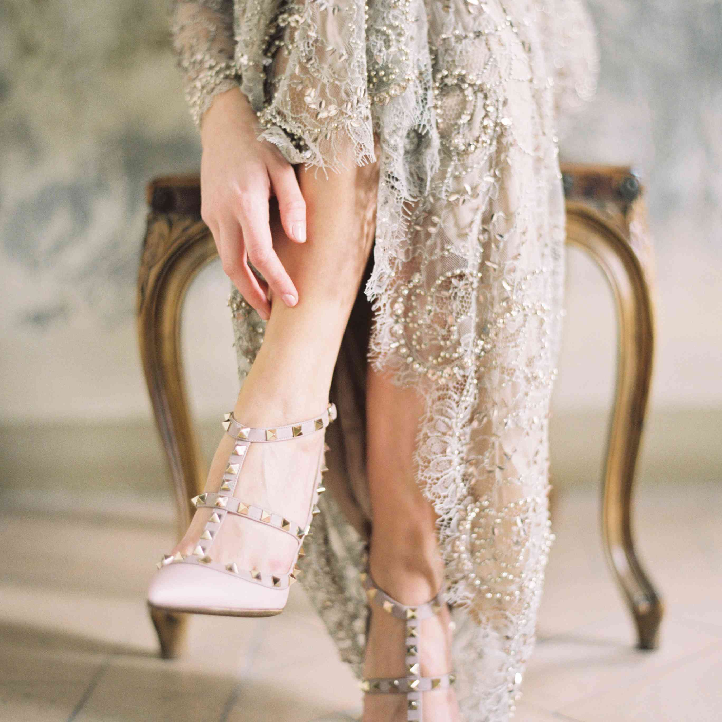 A detail shot captures a bride's Valentino heels and bottom of her wedding dress
