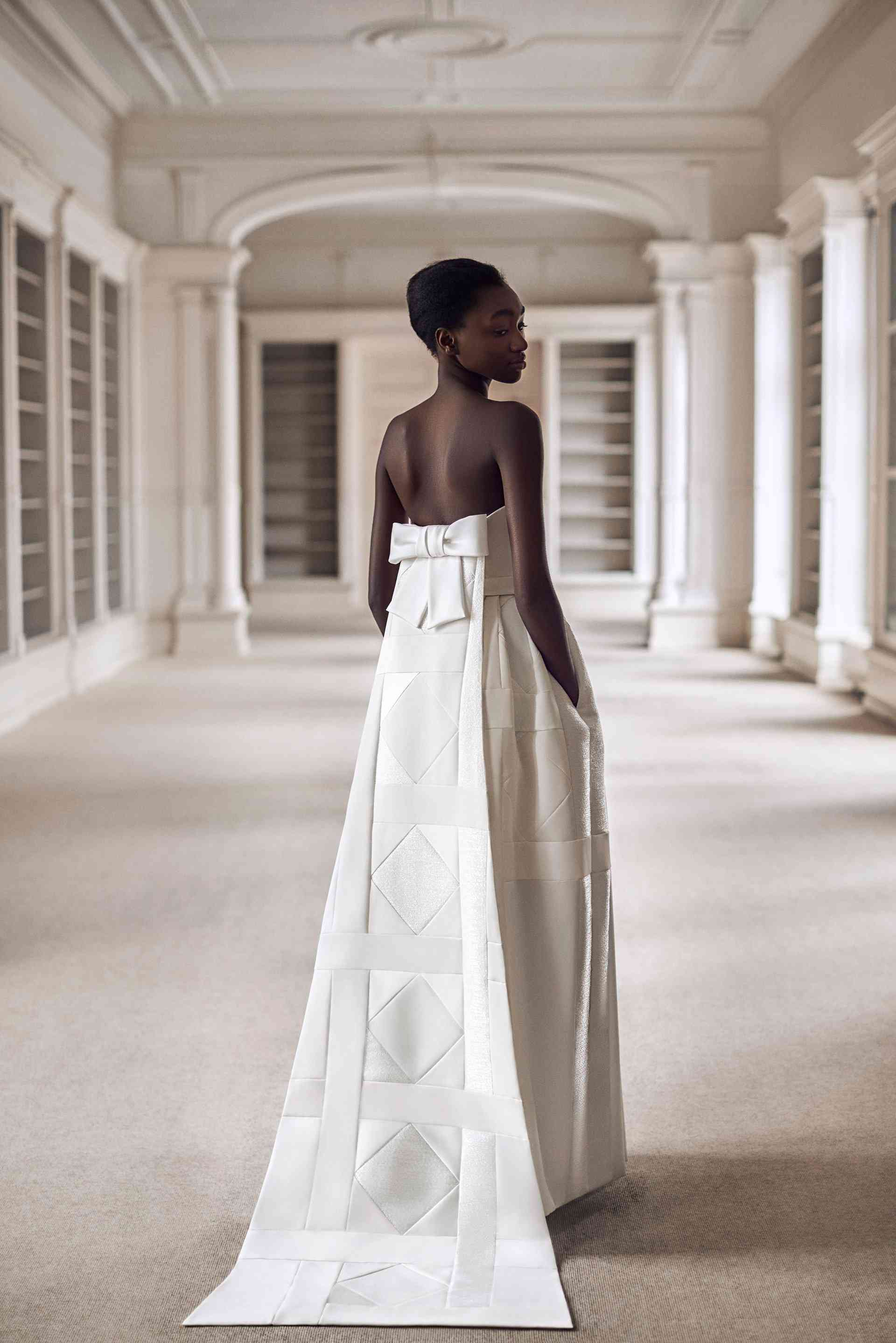 Model in white patchwork wedding gown with pockets