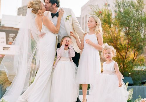 bride and groom with flower girls