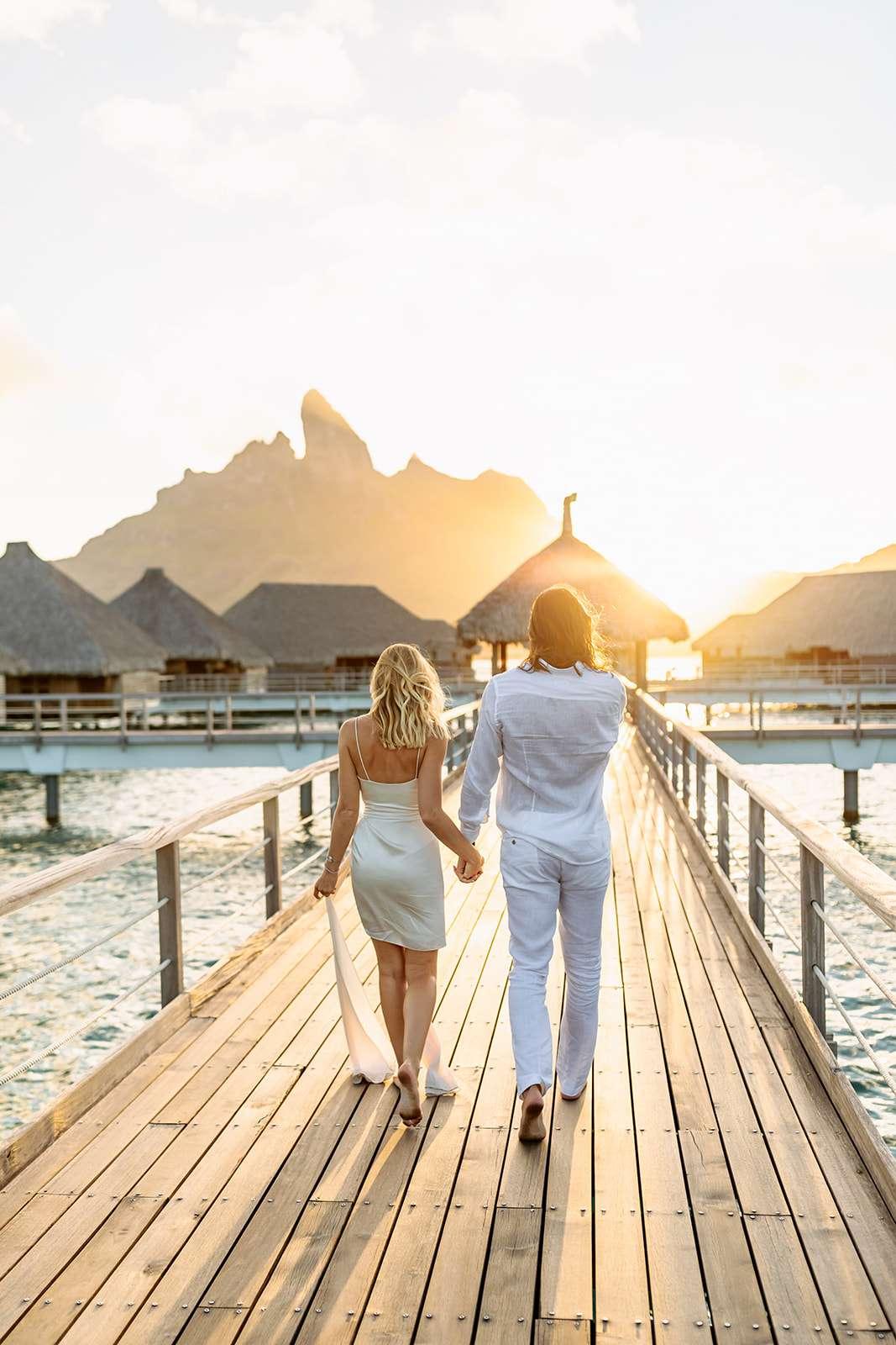 Couple walking into sunset