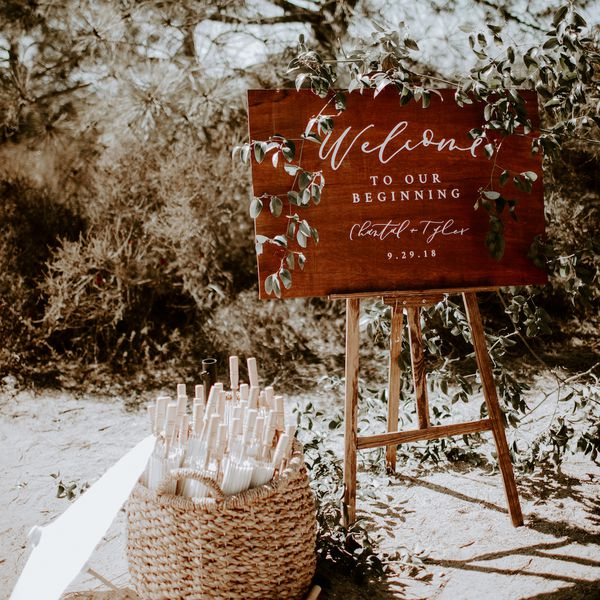 wooden welcome sign with greenery