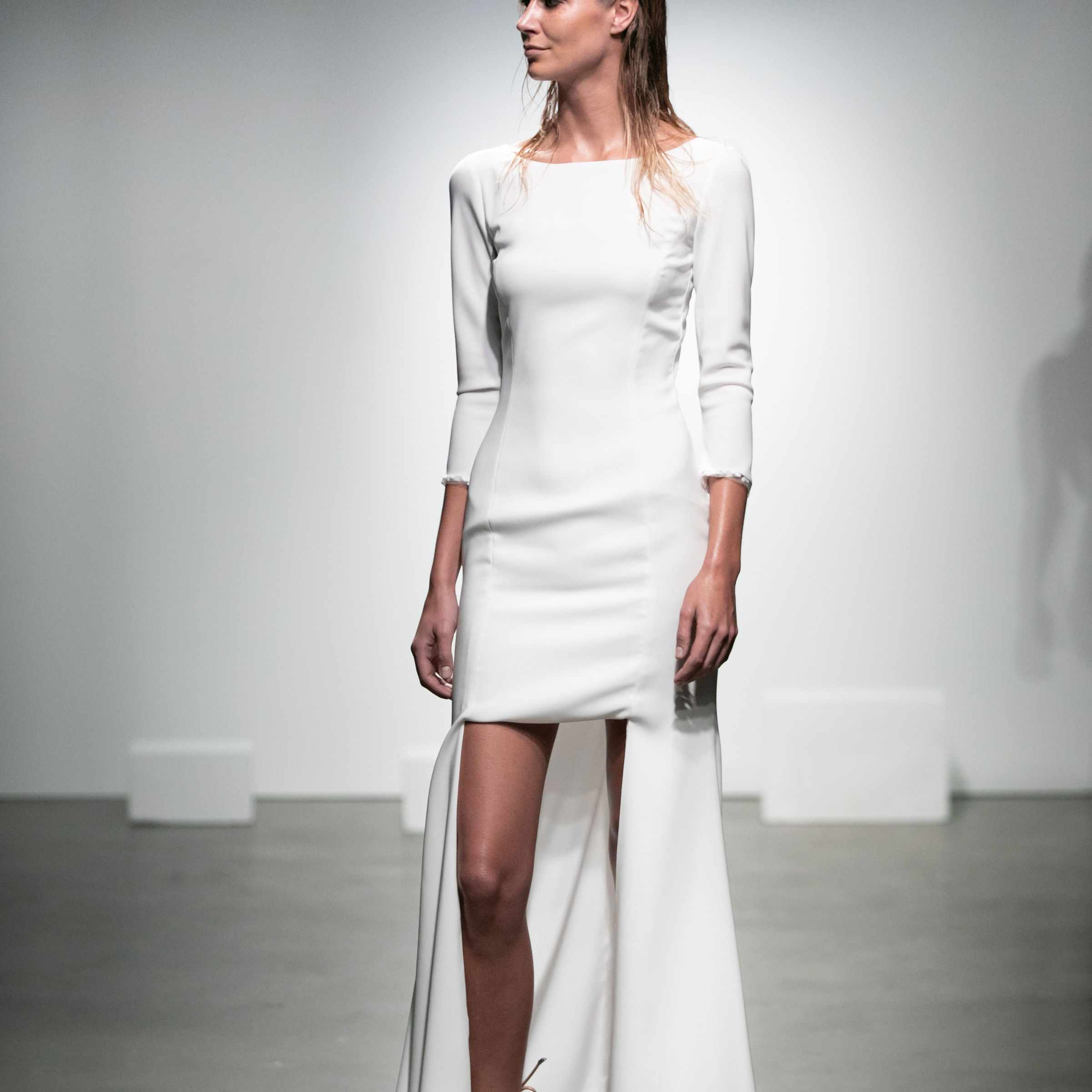 Model in high-low crepe dress with three-quarter sleeves