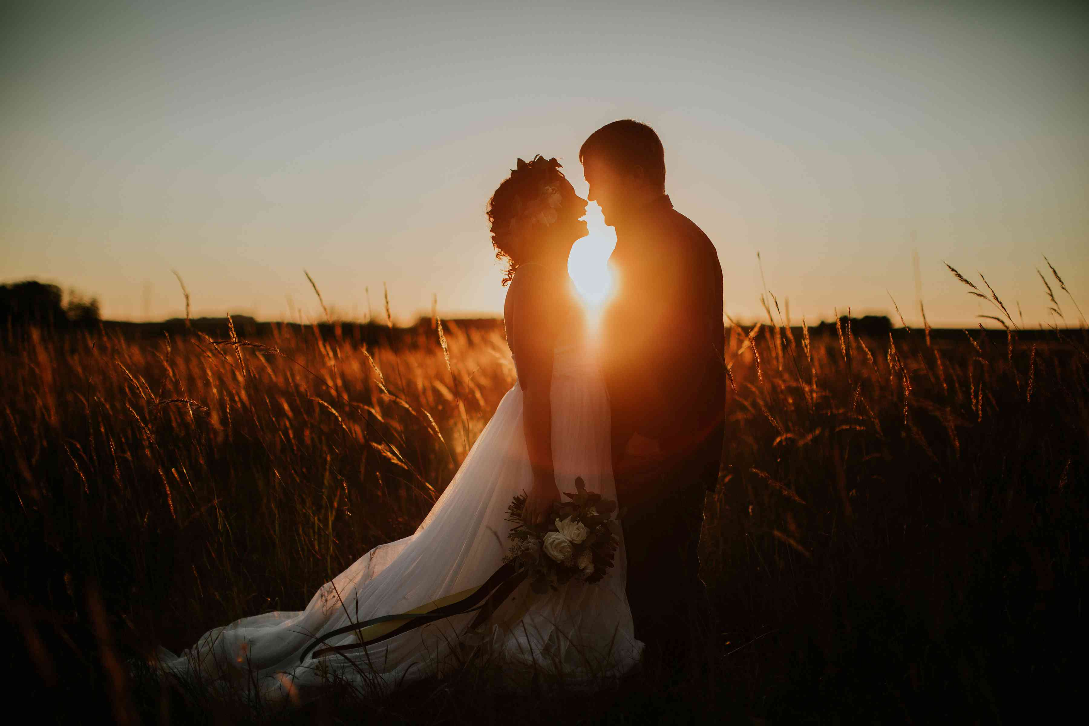 <p>Sunset wedding photo on a farm in Minnesota</p>