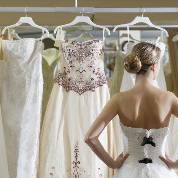 Bride looking at rack of dresses