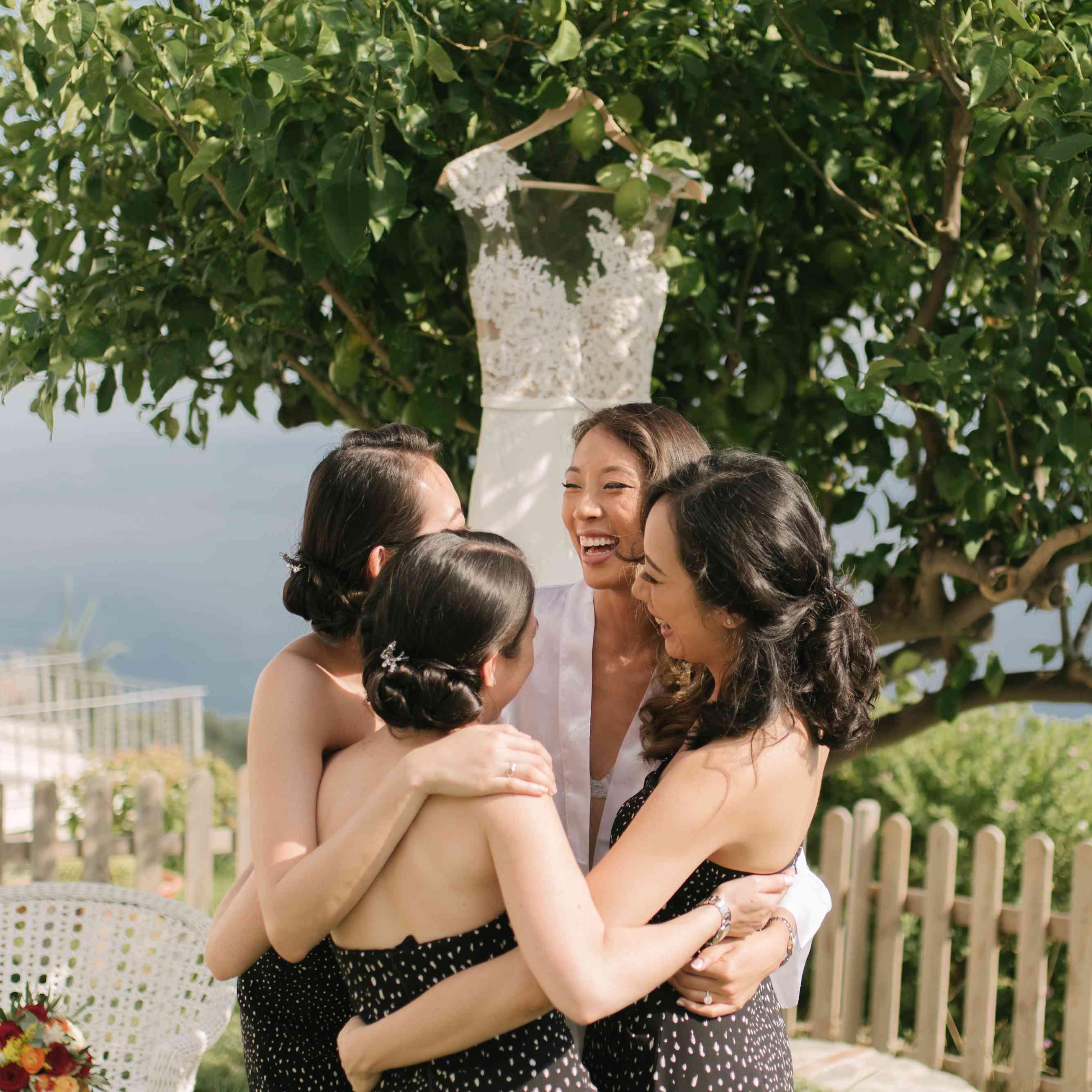 Bride Hugging Her Bridesmaids