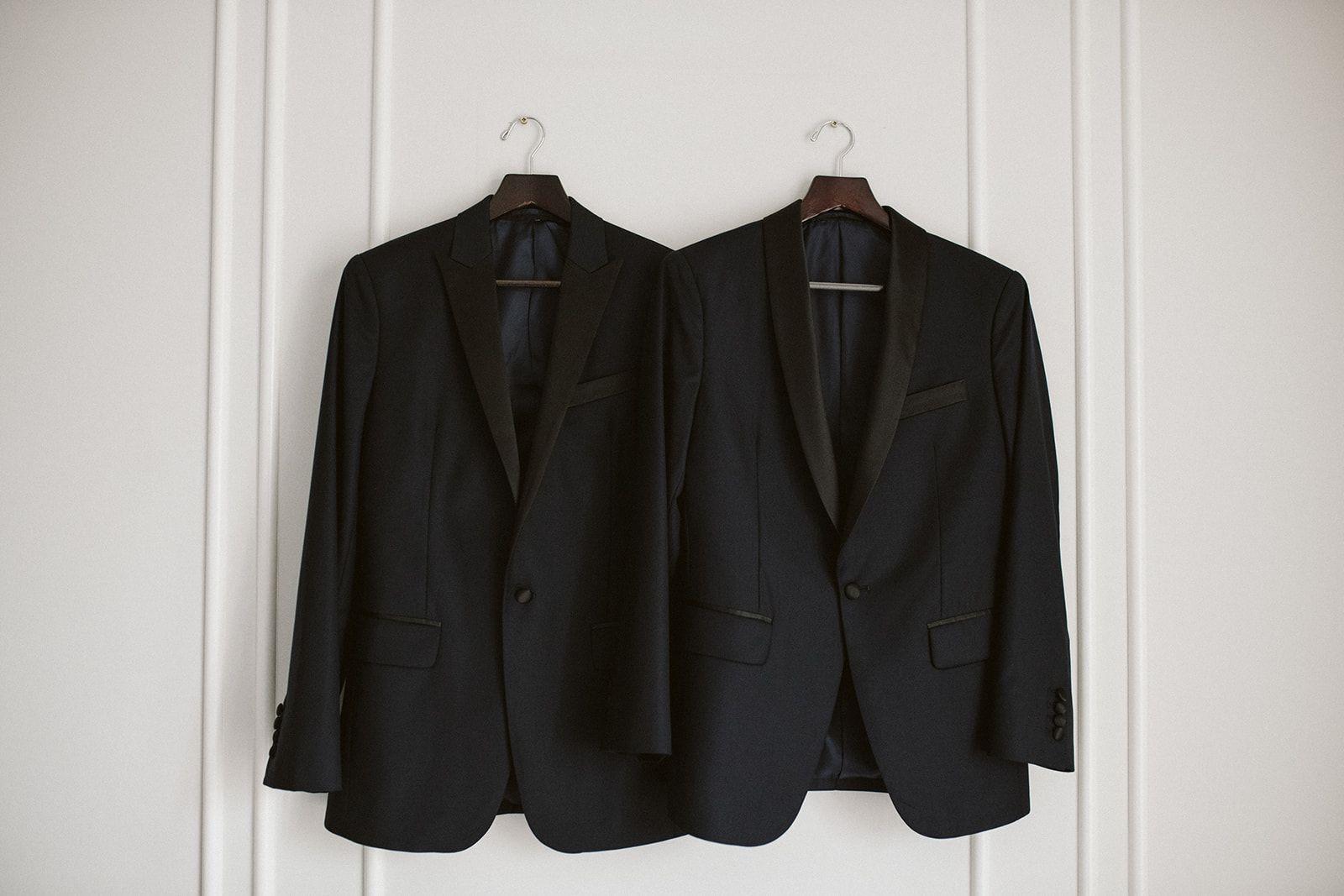 Pair of tuxedo jackets hanging up