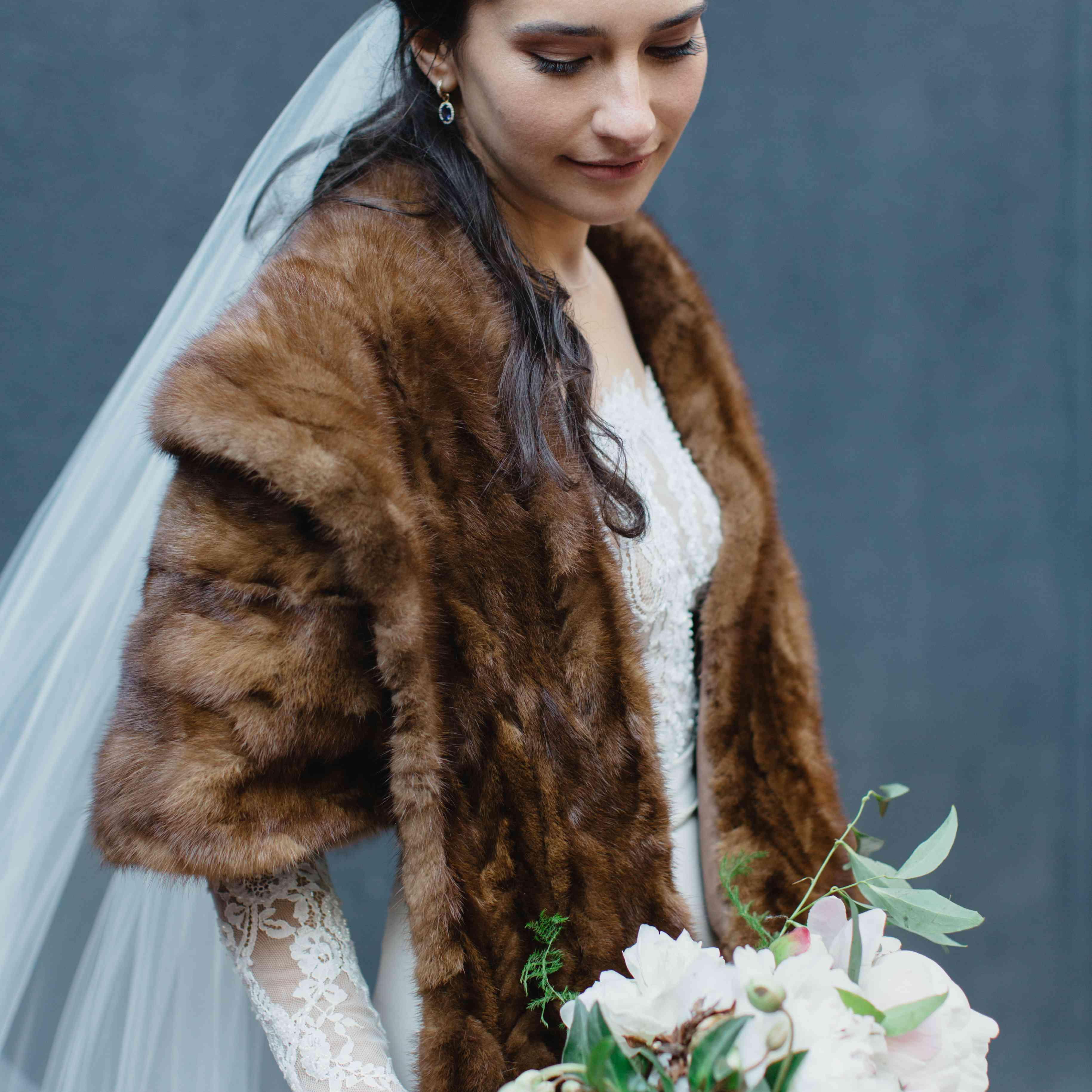 Bride wearing fur shawl