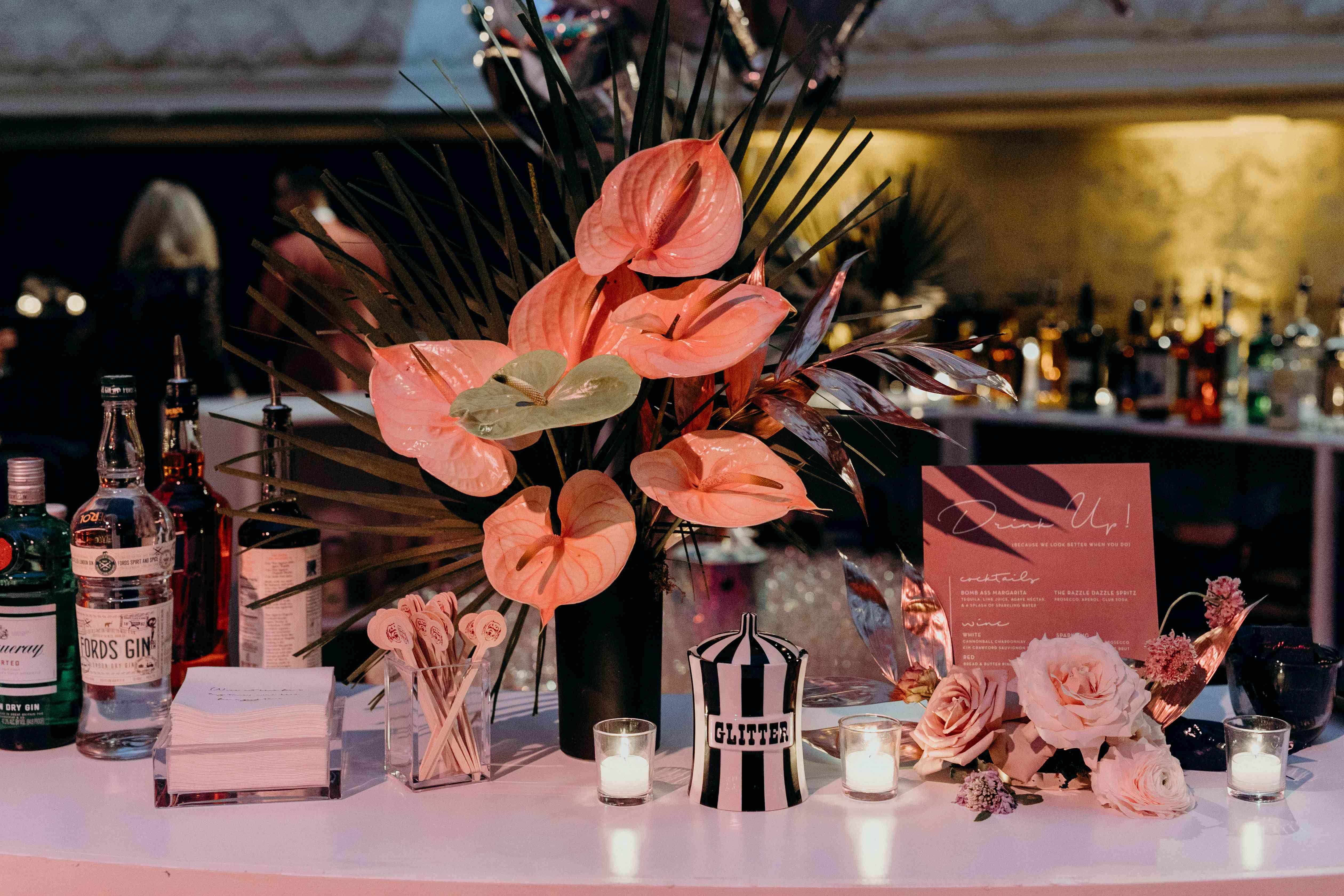 custom drink set up with floral arrangement
