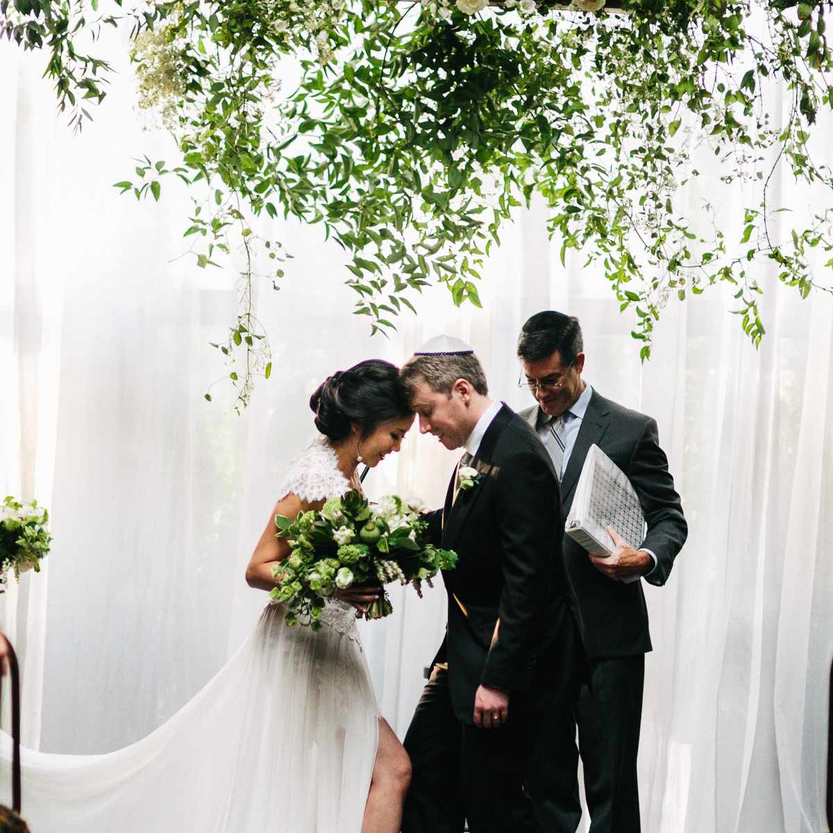 Bride and groom smash glass