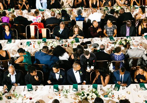 Family sitting for wedding dinner