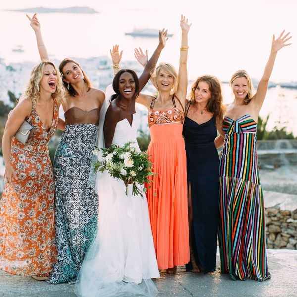 Bride on her wedding day surrounded by a group of girlfriends