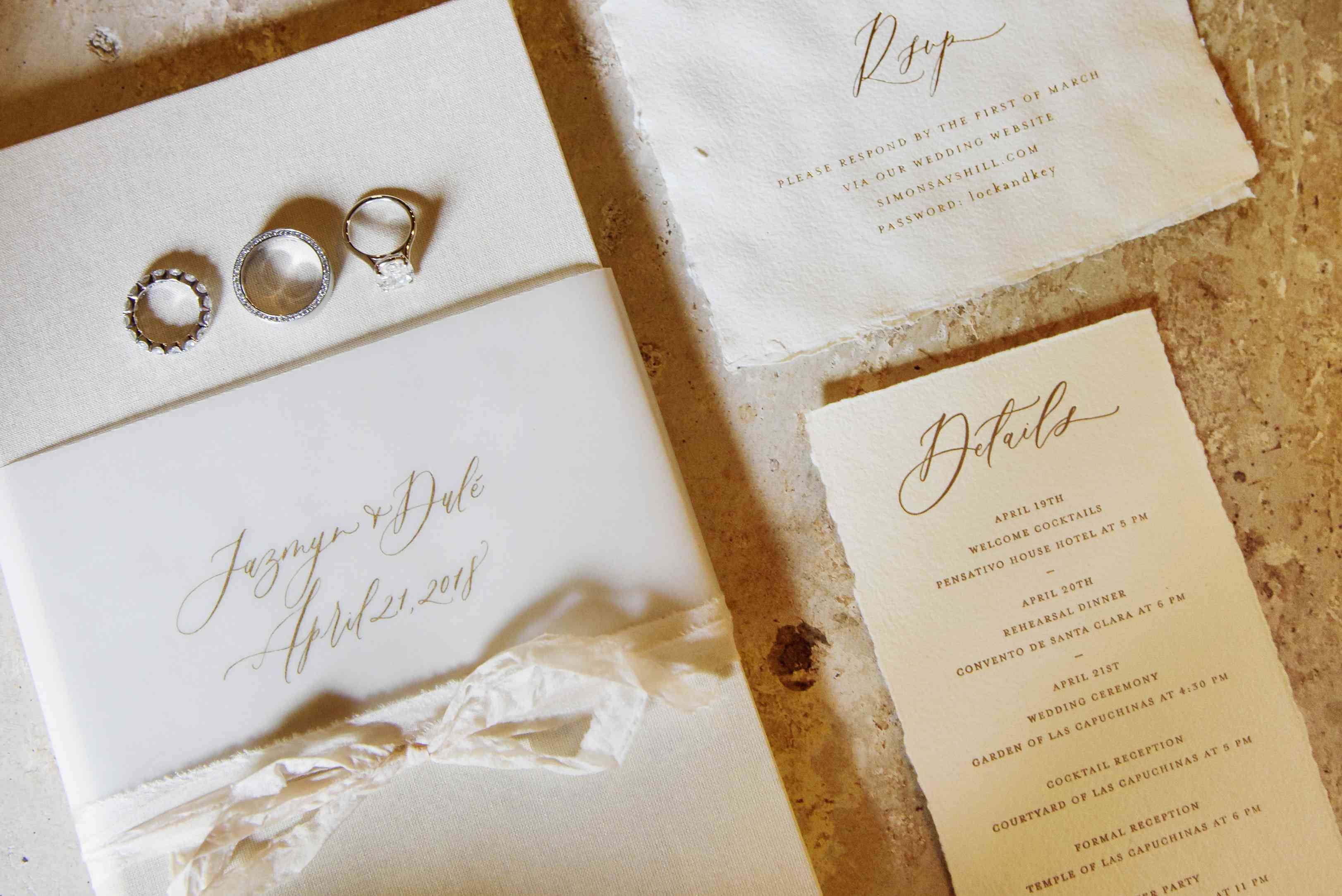 invitation suite and wedding rings
