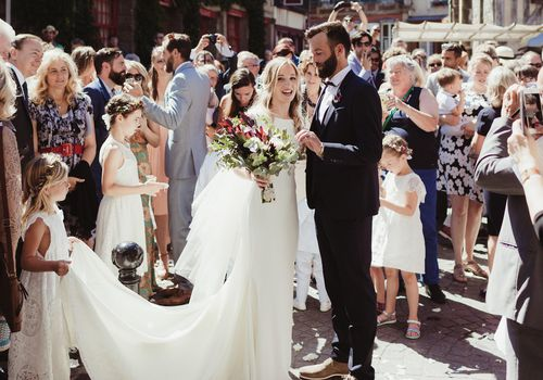 <p>Bride and Groom with Wedding Guests</p>