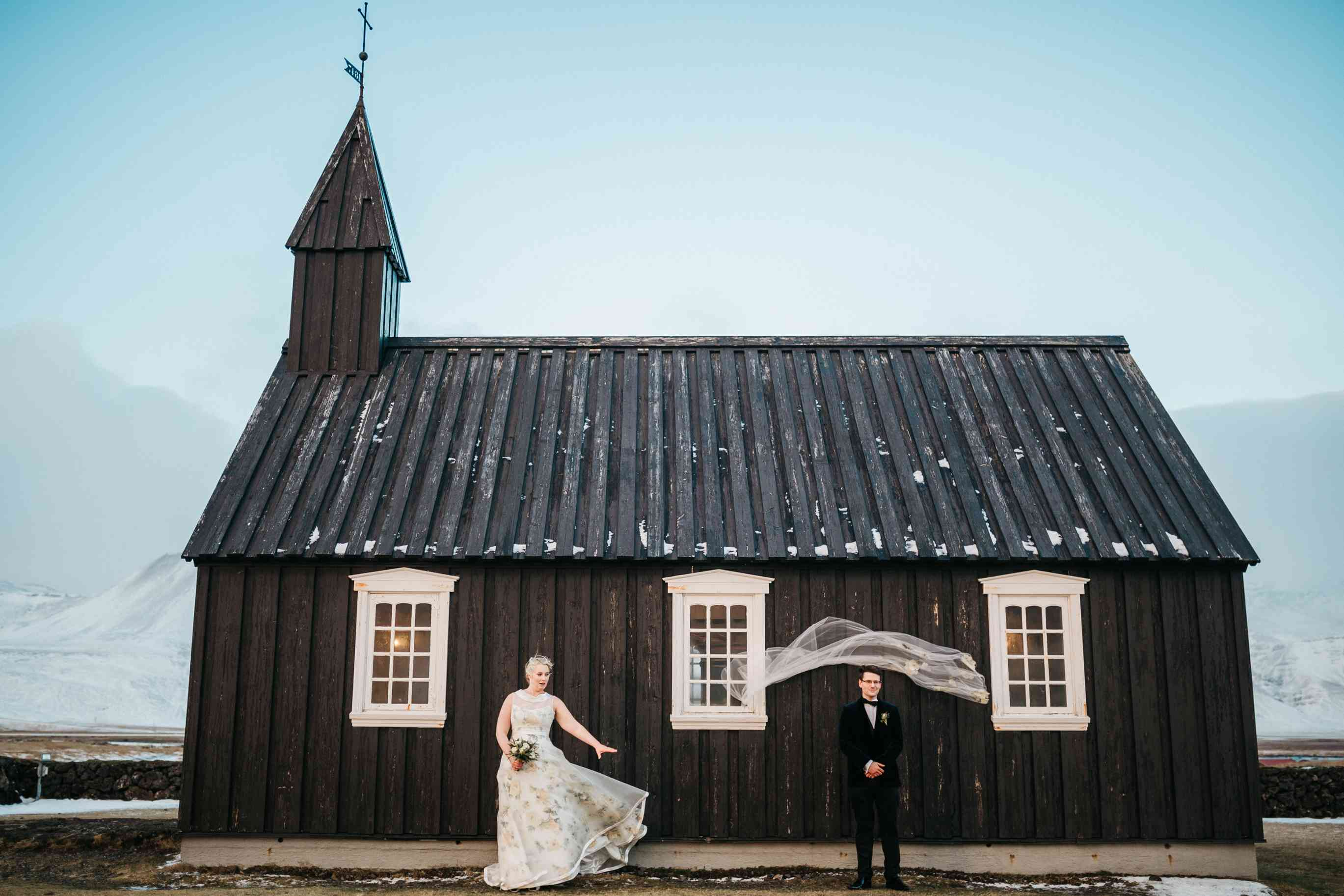 Couple in front of Budir Church in Iceland