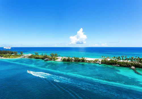 Palm trees and emerald water at Caribbean Nassau, Bahamas