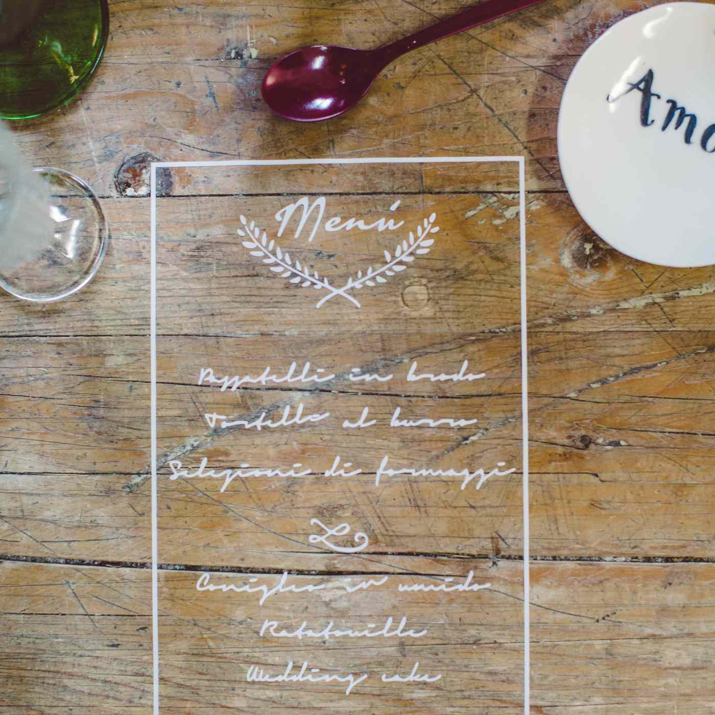 Wedding Menu Written on Wooden Table