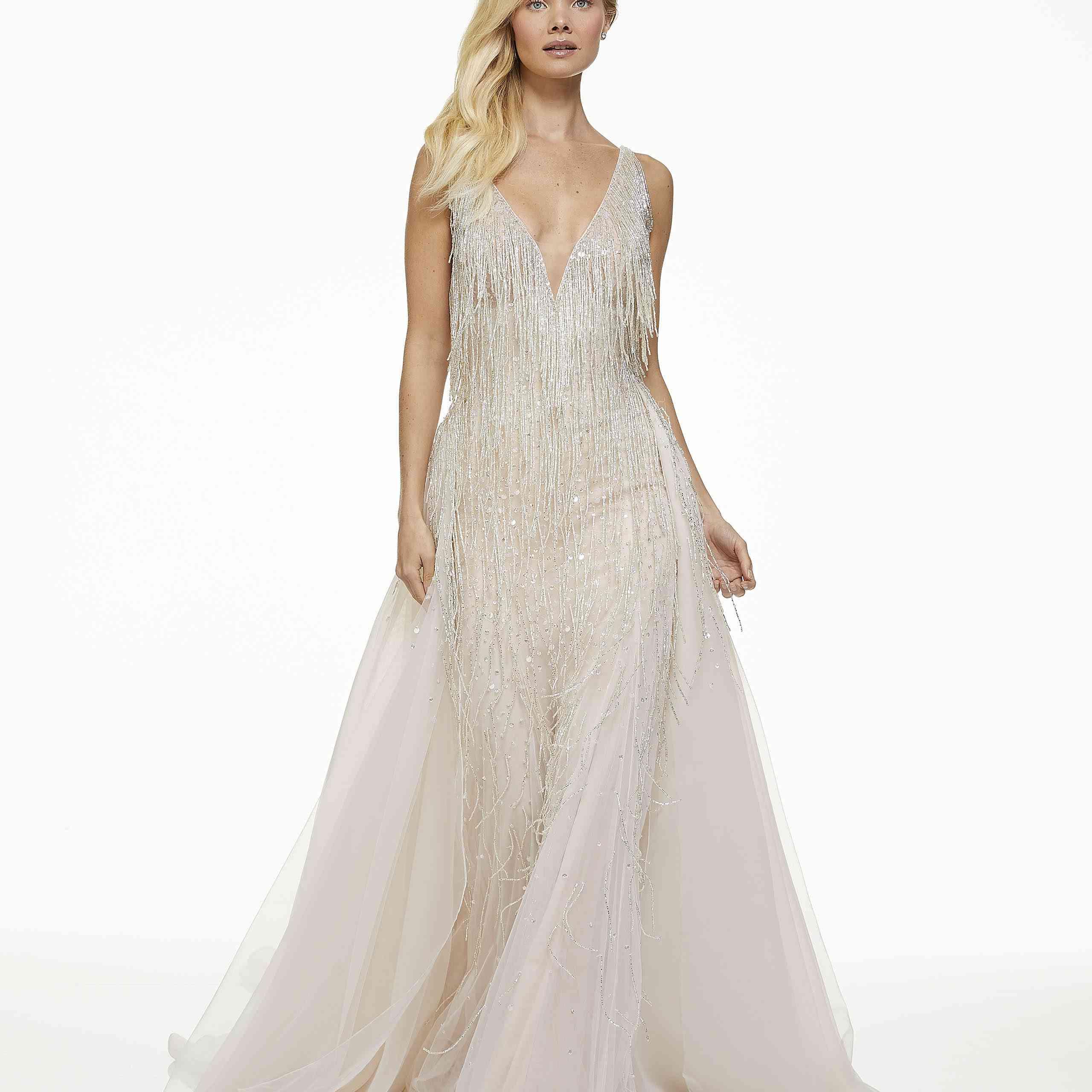 Model in deep v-cut fringe wedding dress