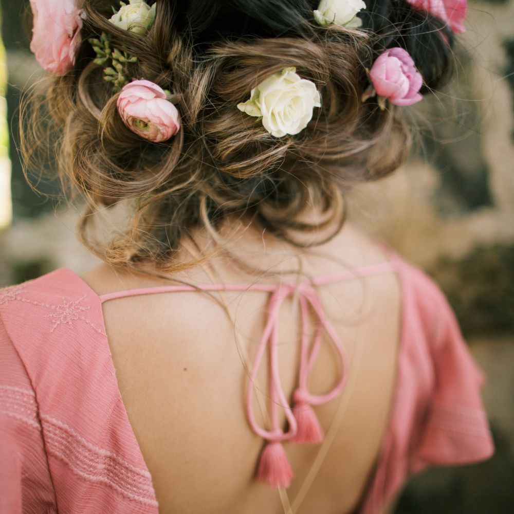Hair gathering with roses tucked in