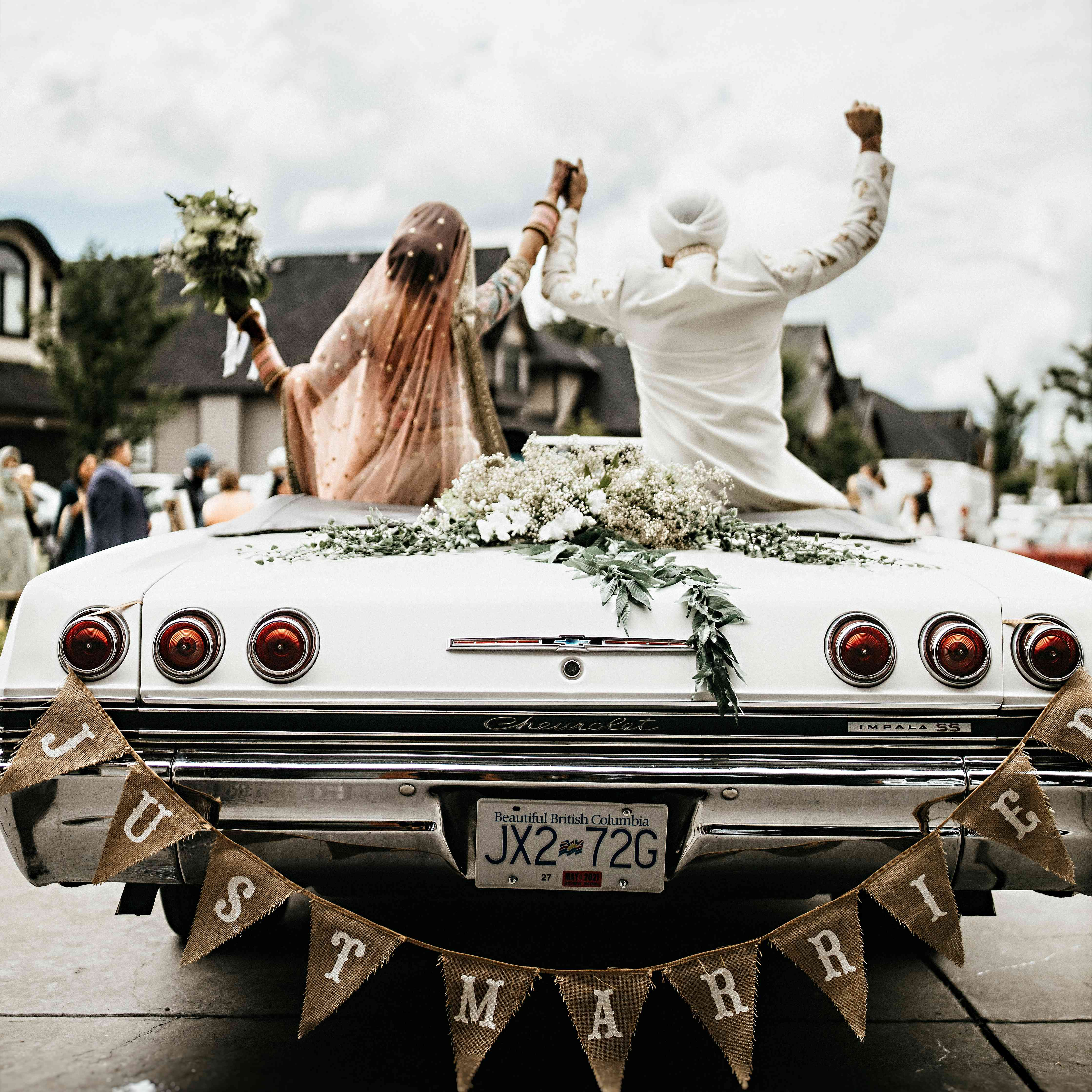 Newlyweds in getaway car with