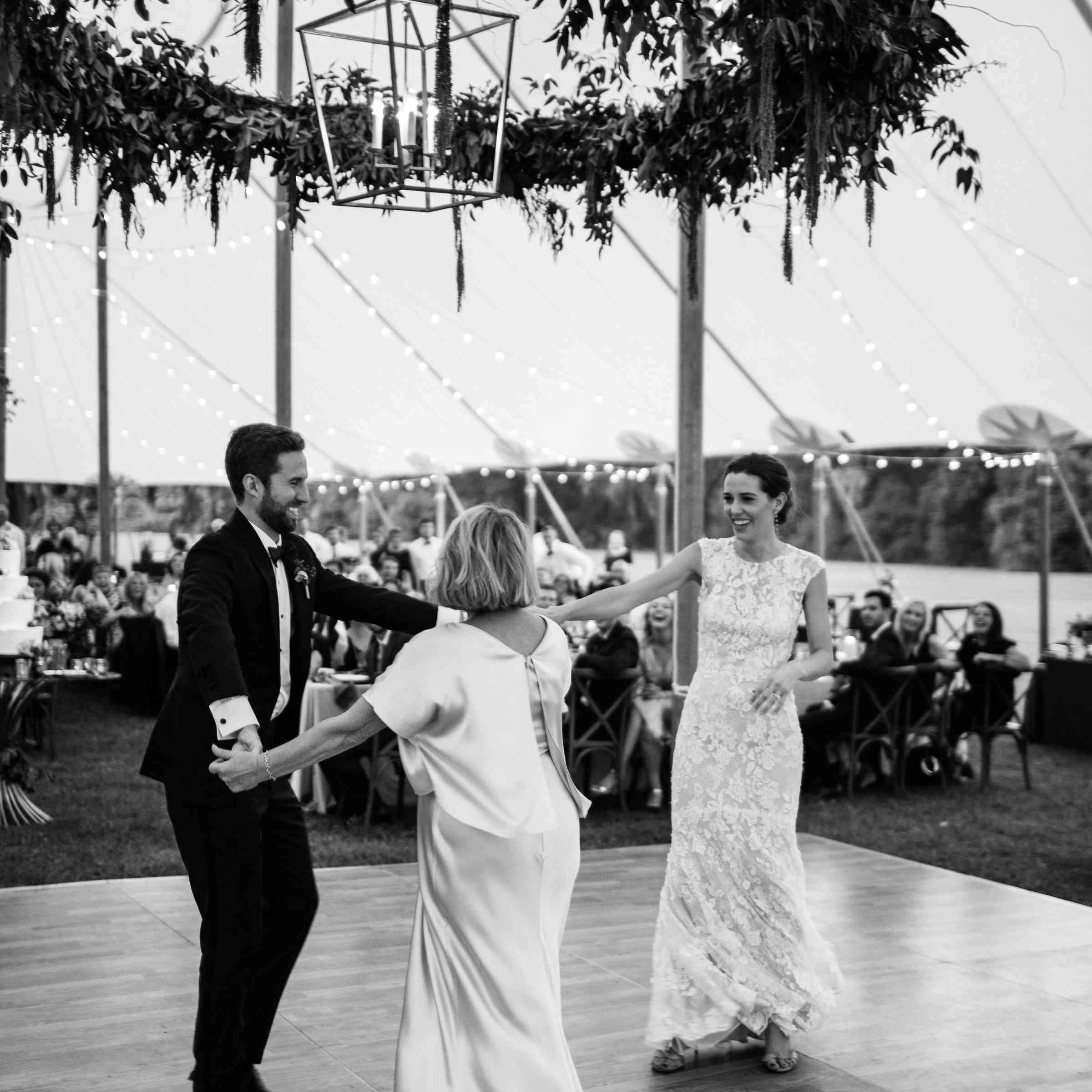 Bride and groom dancing with mother