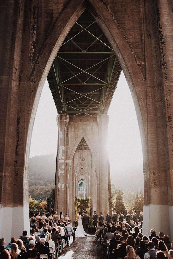 Wedding ceremony under arched bridge