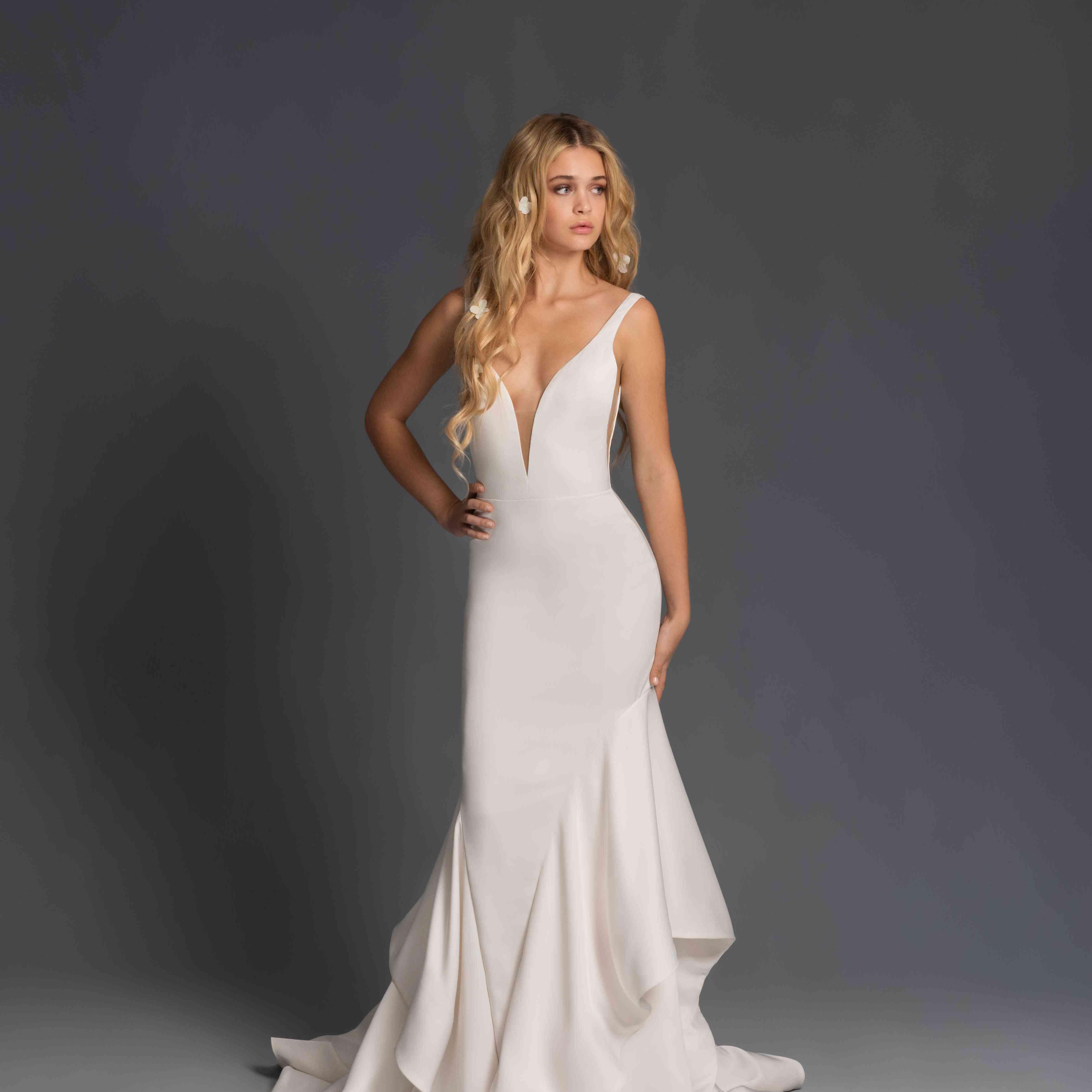Model in plunging cascading ruffle wedding dress