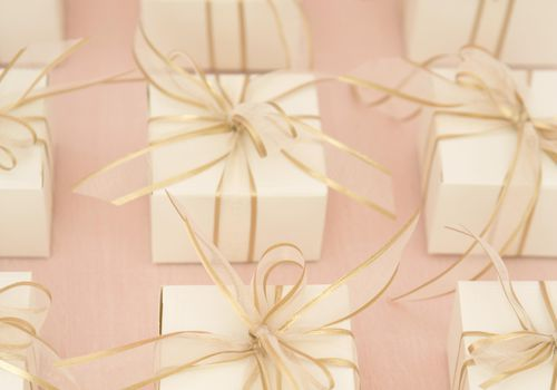 Gift boxes with gold ribbons