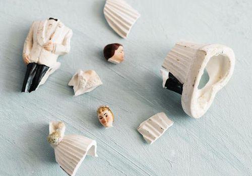 broken bride and groom figurines