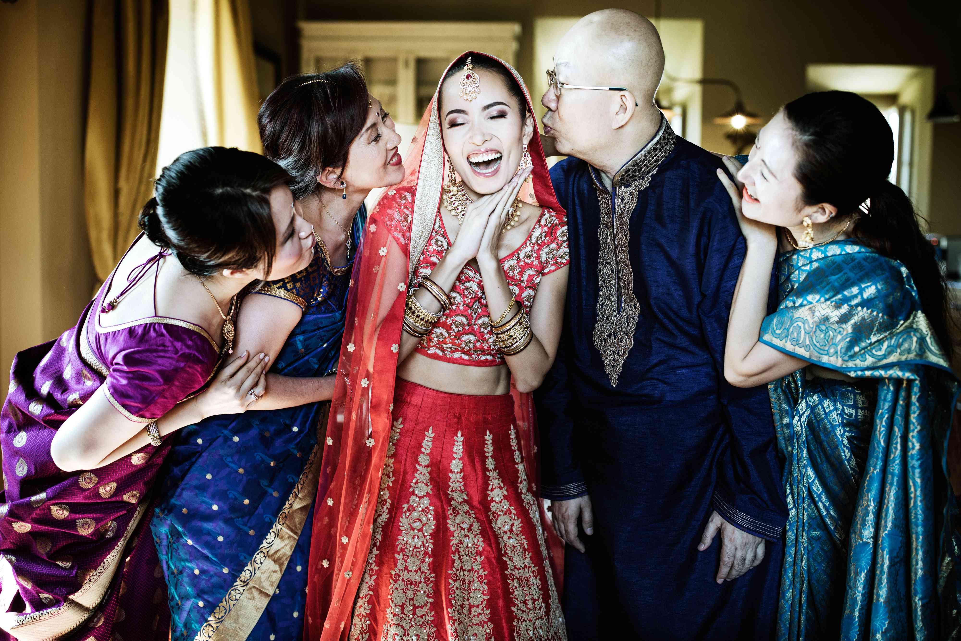 bride in lehenga with her family