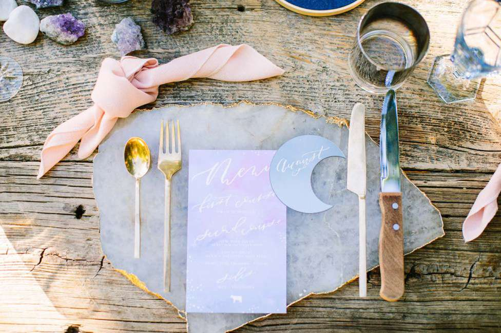 Table setting with crescent details and a crystal place mat