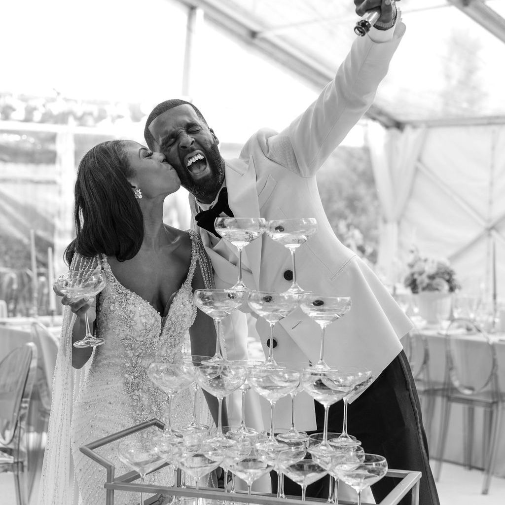 bride and groom with champagne tower