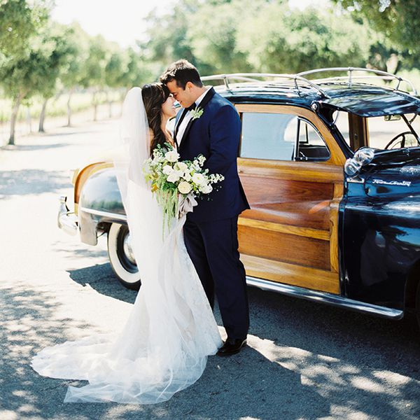 couple in front of getaway car