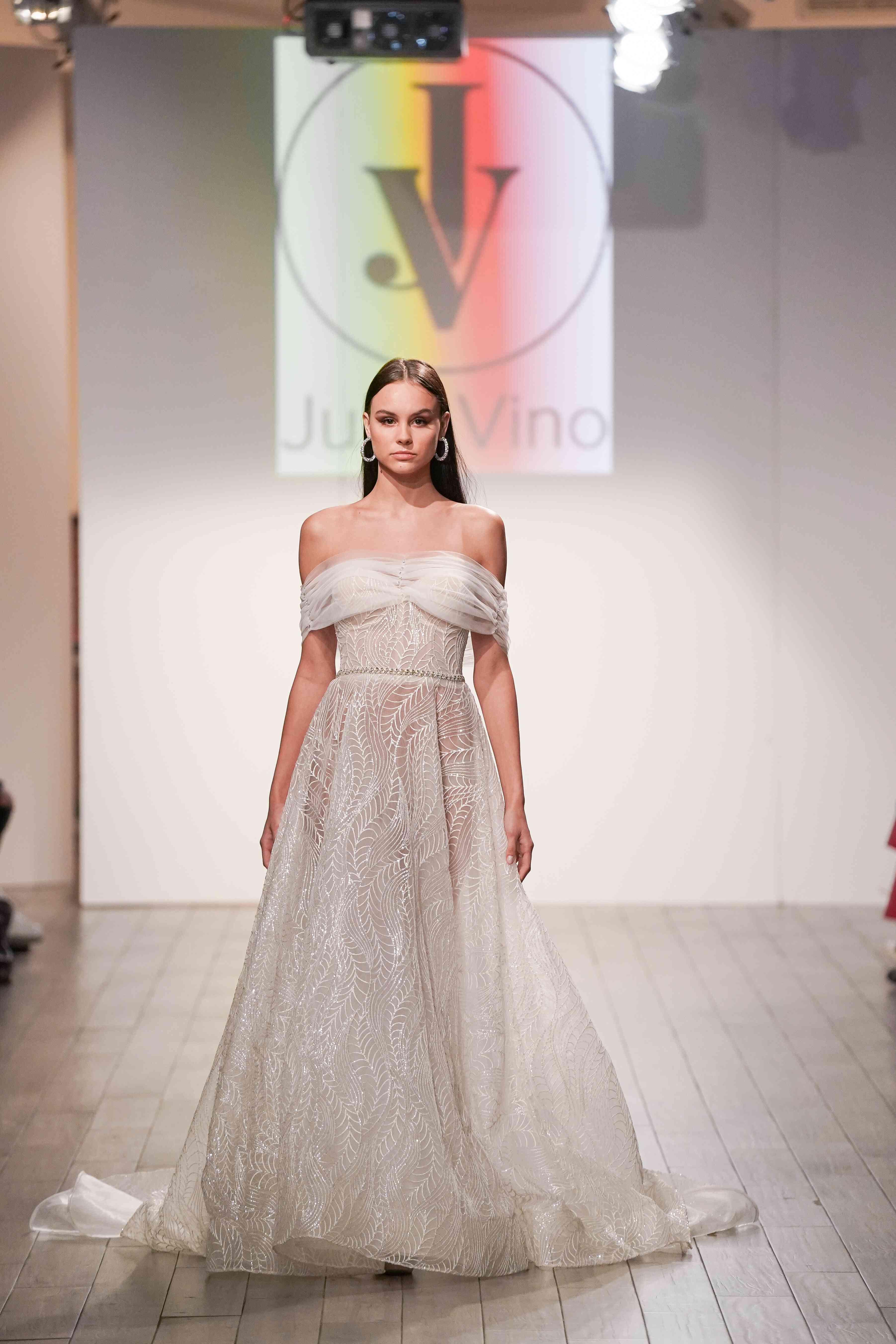 Model in off-the-shoulder laser-cut wedding dress