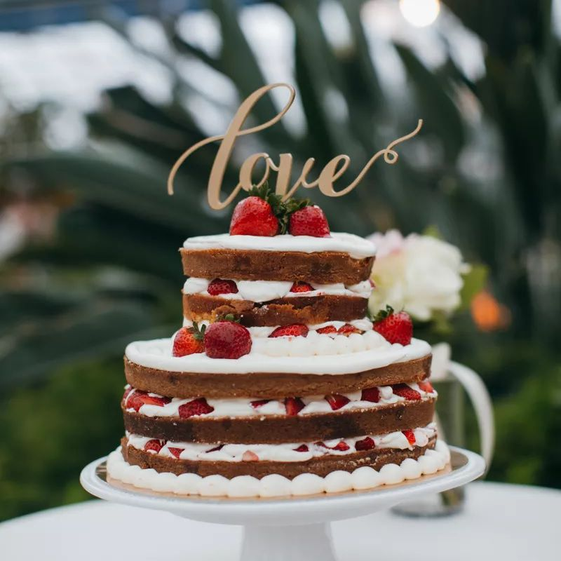 Layered naked cake with strawberries and cream
