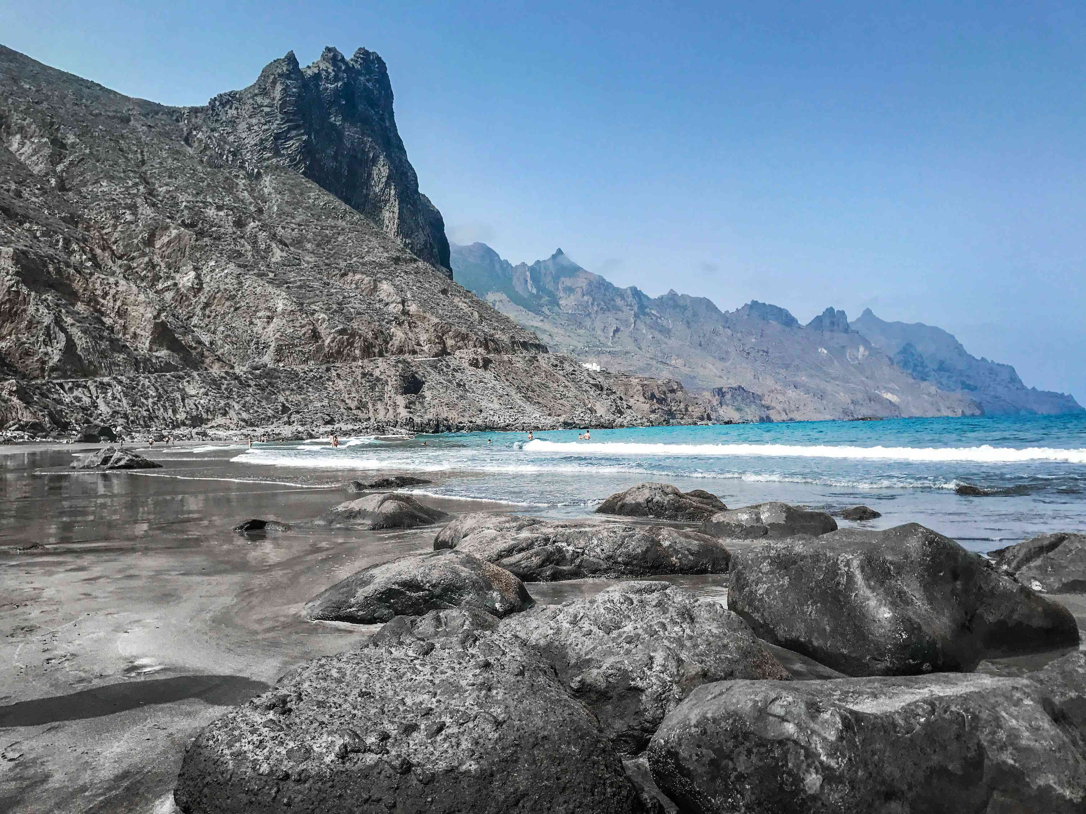 Volcanic mountains and black-sand beaches in Tenerife, Spain